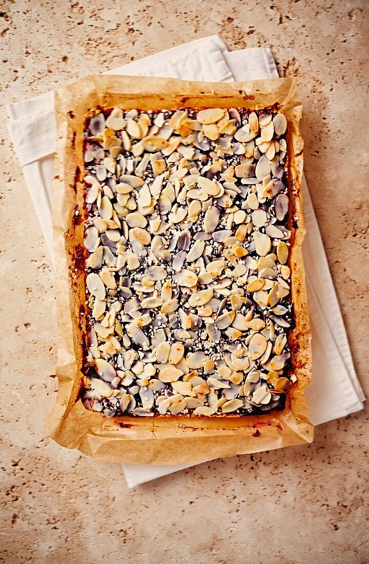 Sugar-free and fat-free flapjacks with almonds and raspberry jam