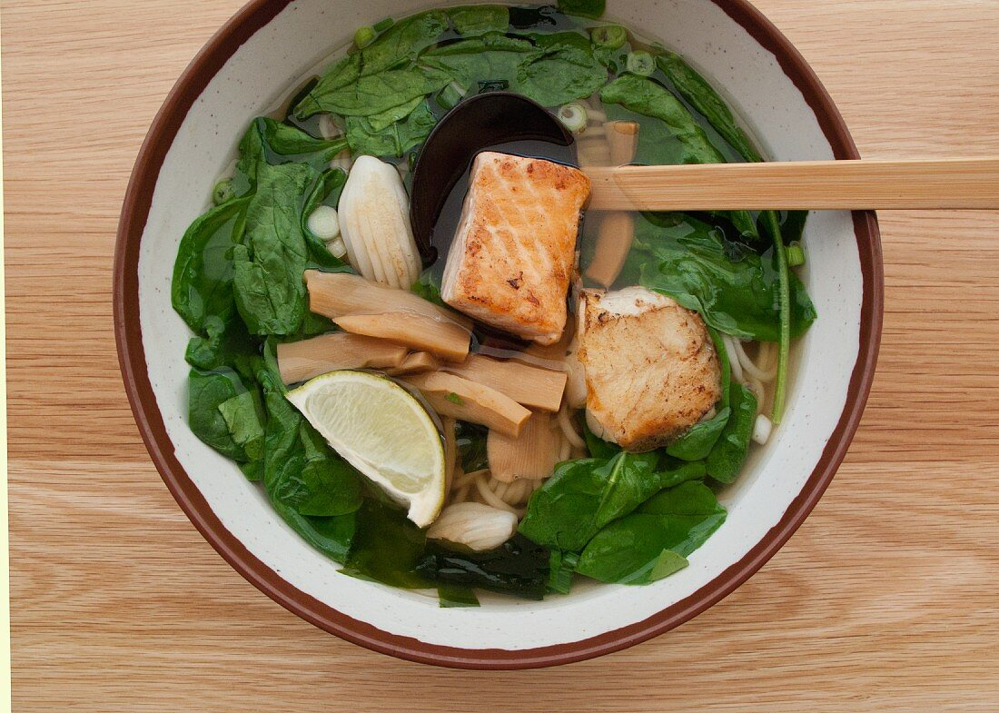 Udon noodle soup with salmon and spinach