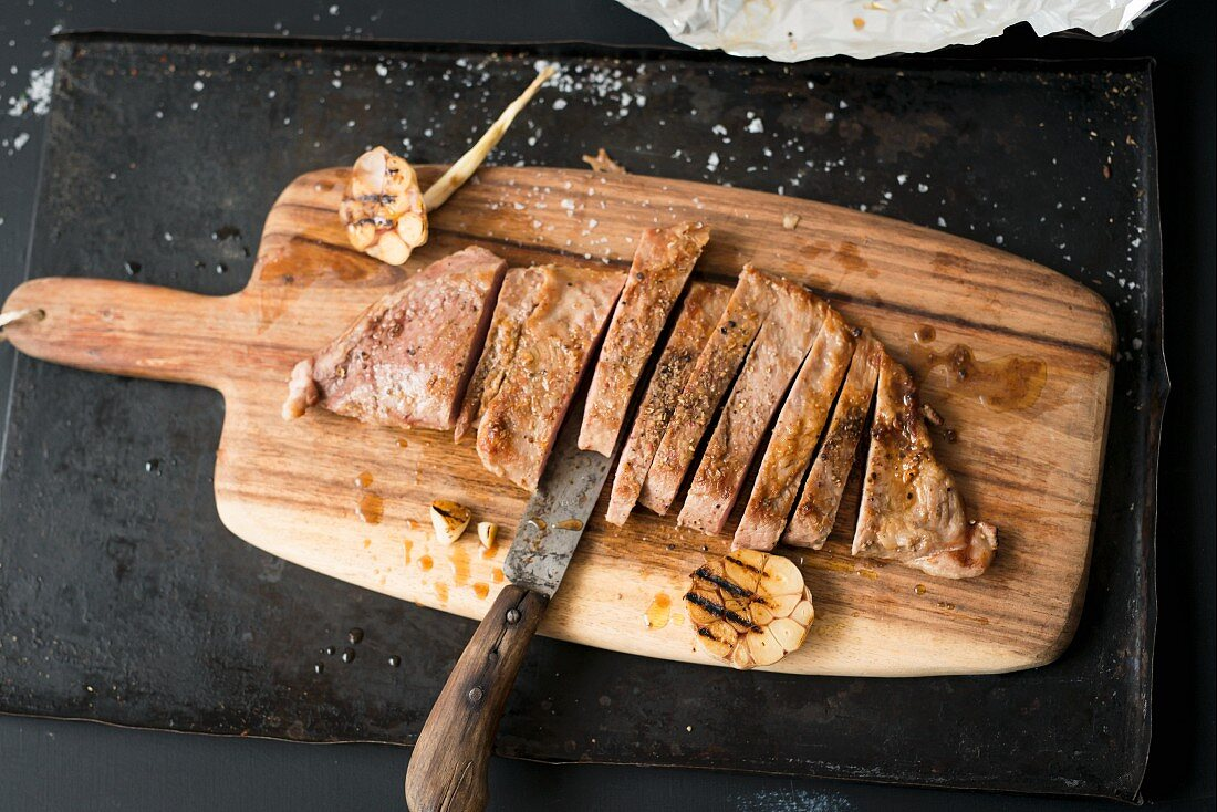 Grilled Iberico pork secreto (fillet steak) with garlic