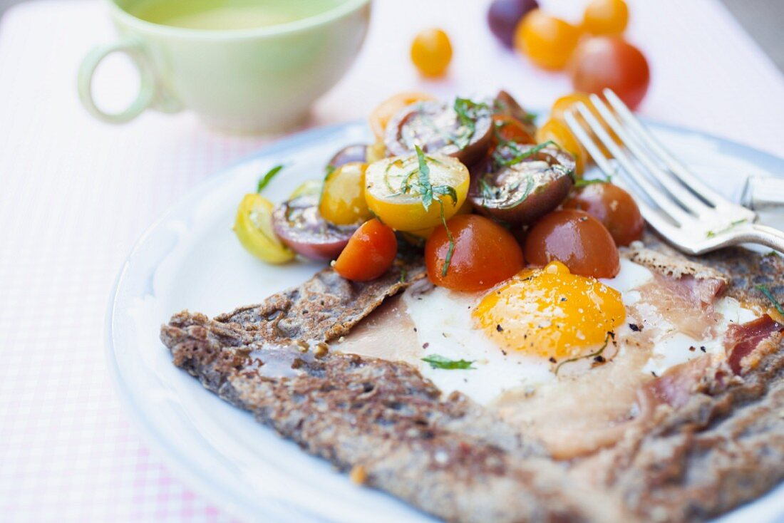 Galette with ham, fried egg and mini Heirloom tomatoes (Breton)