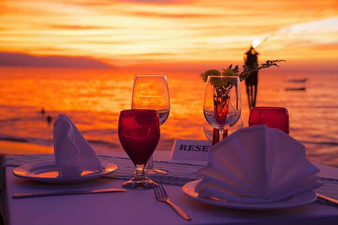 Dinner on the beach at sunset in the city centre of Puerto Vallarta, Jalisco, Mexico