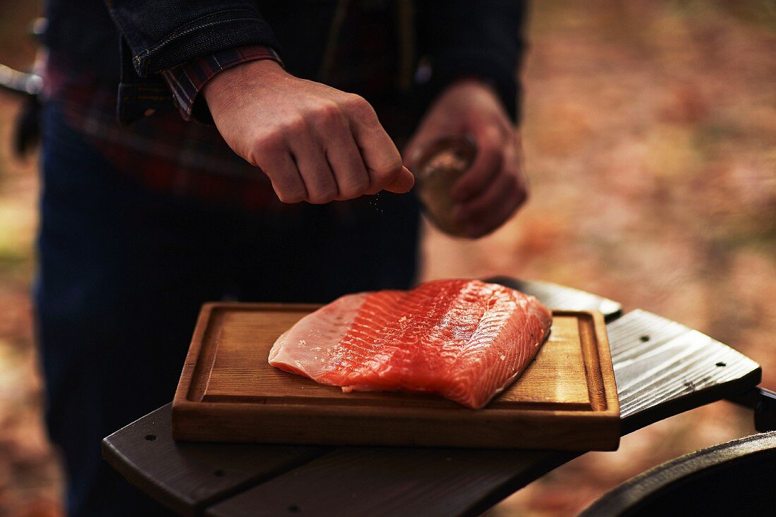 Salmon being prepared for grilling
