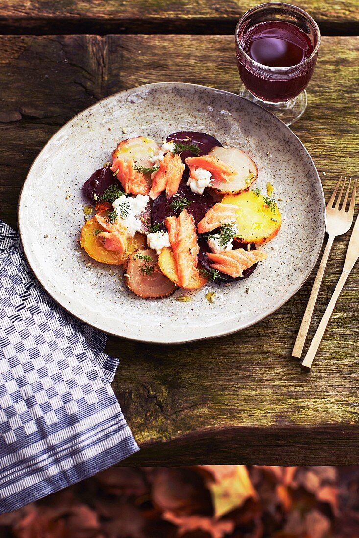Grilled salmon on a bed of turnips and root vegetables