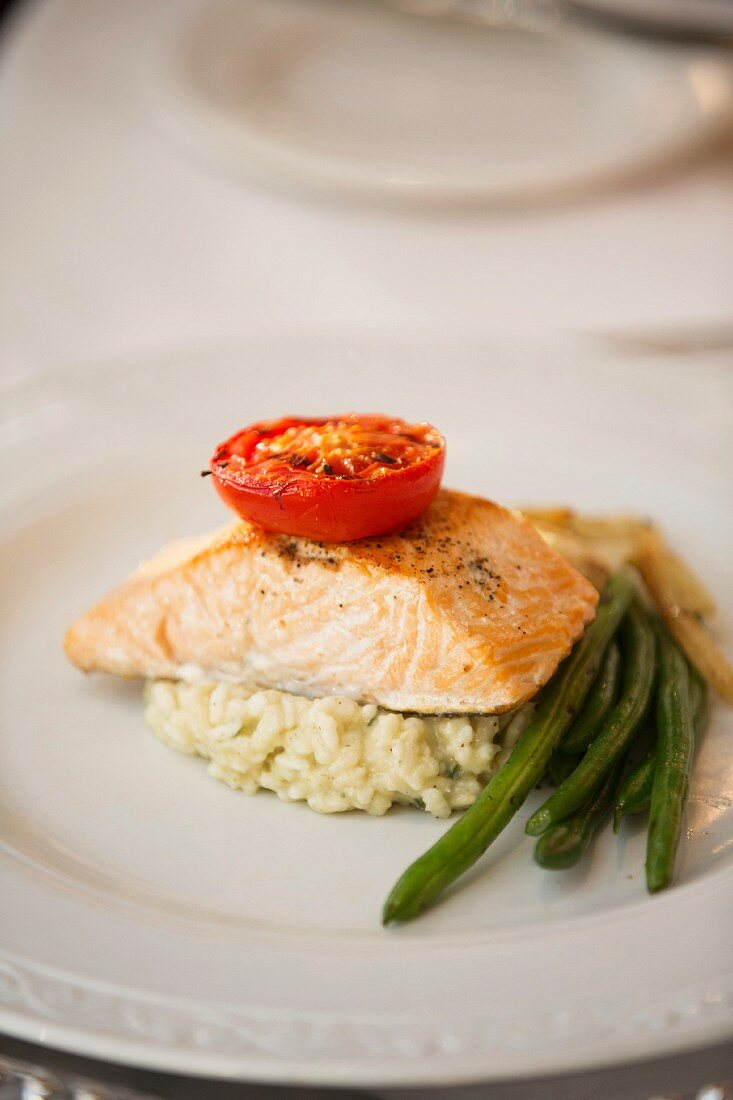 Salmon fillet on rice with green beans