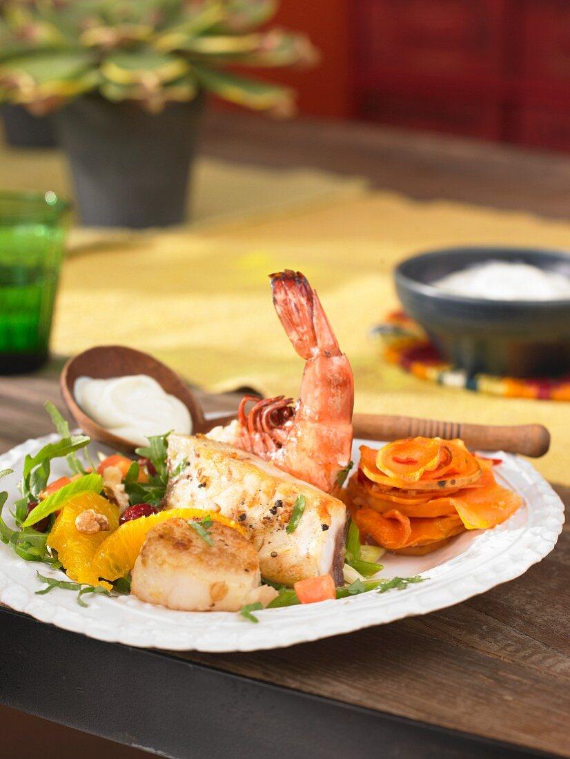 A seafood platter with a wasabi dip and a papaya salad