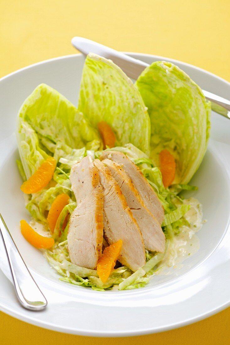 A chicken breast and orange salad