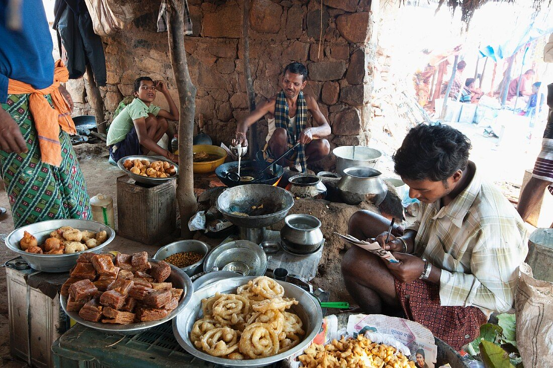 Jelabi and other sweets being made at a weekly market, Guneipada, Koraput district, Orissa, India
