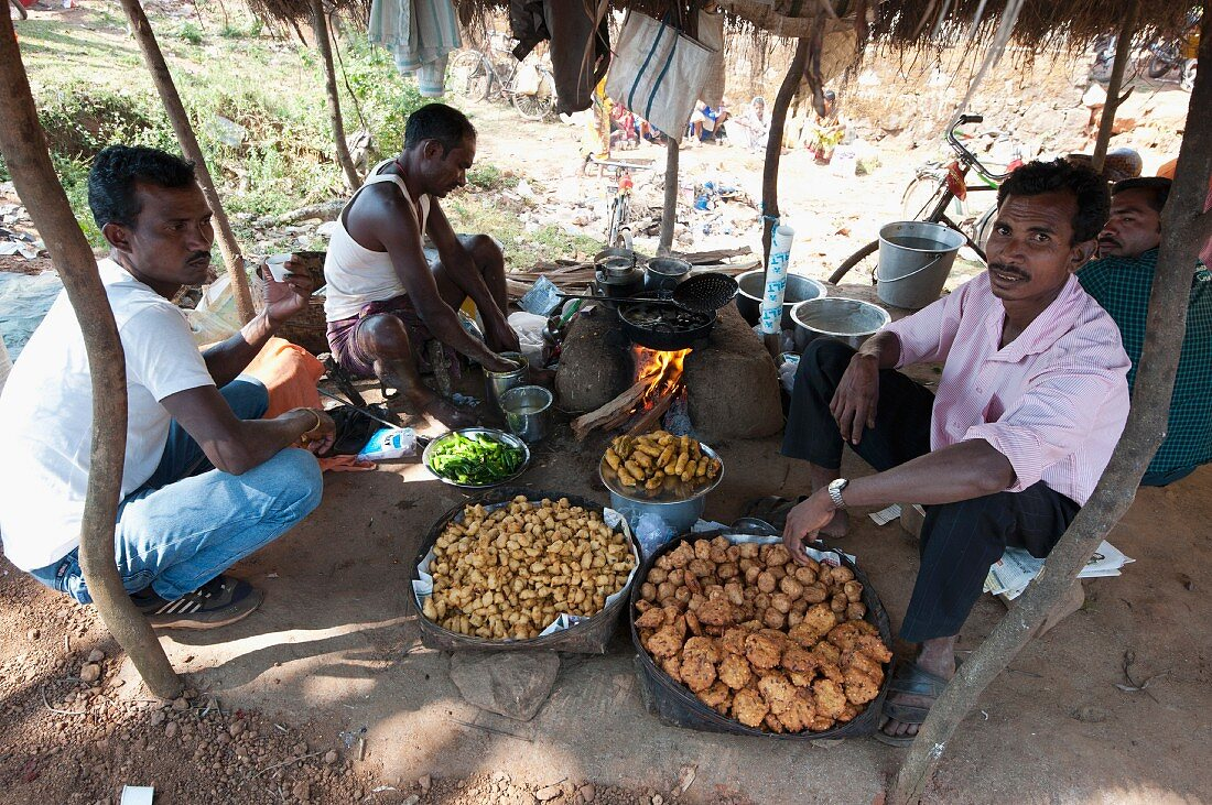 A stall sanding bhaji and savoury snacks at a weekly market, Guneipada, Koraput district, Orissa, India