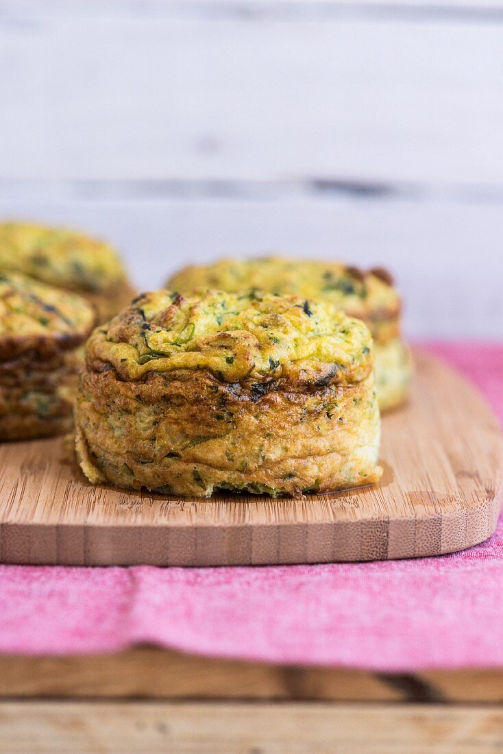 Cauliflower and courgette cakes on a wooden board