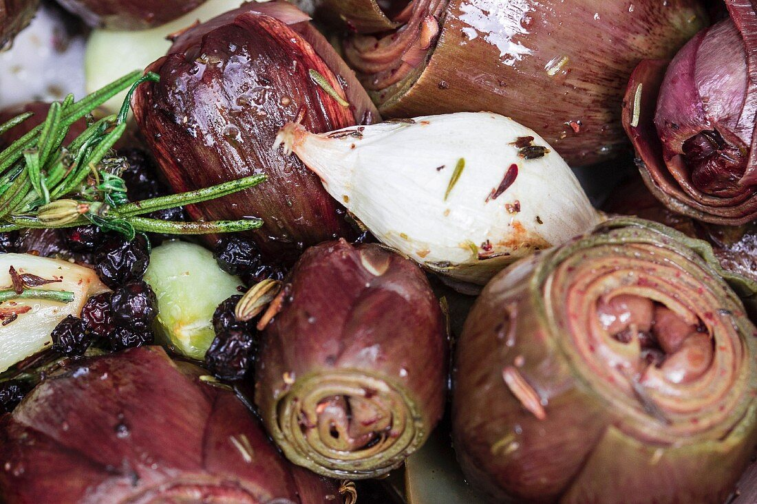 Baby artichokes in olive oil with anise, cardamom, rosemary, barberries and spring onions