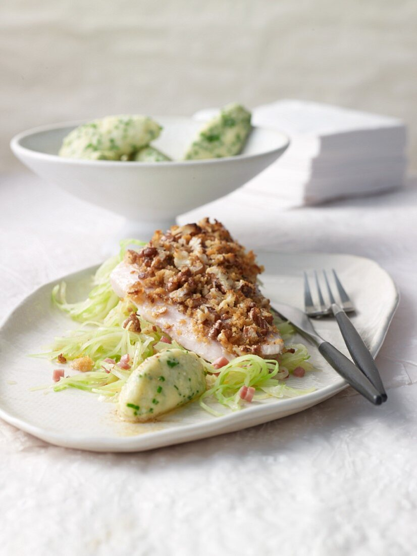 Whitefish fillet with a light nut crust on Bavarian cabbage with semolina dumplings