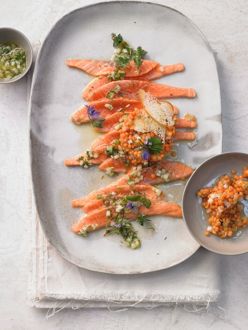 Gratinated char carpaccio with a fennel and orange vinaigrette and a caramelised red lentil salad