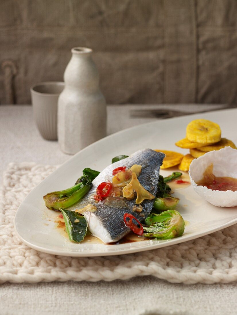 Seabream fillet with a chilli and ginger vinaigrette, bok choy and baked plantains