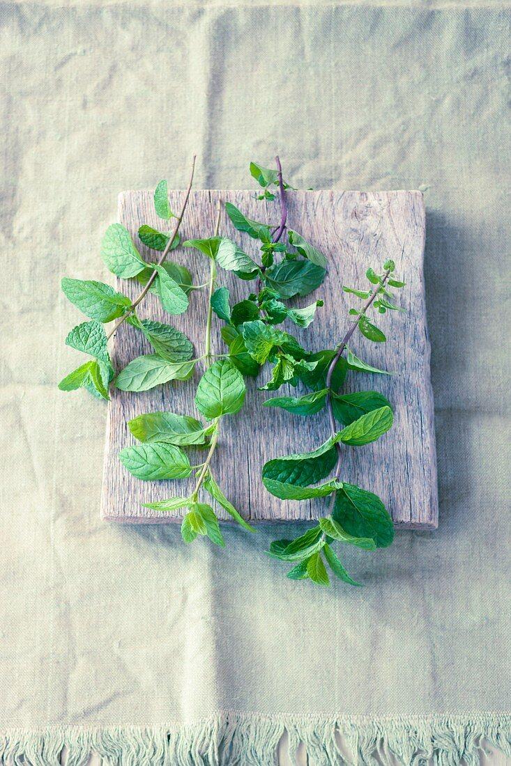 Fresh mint on a wooden board