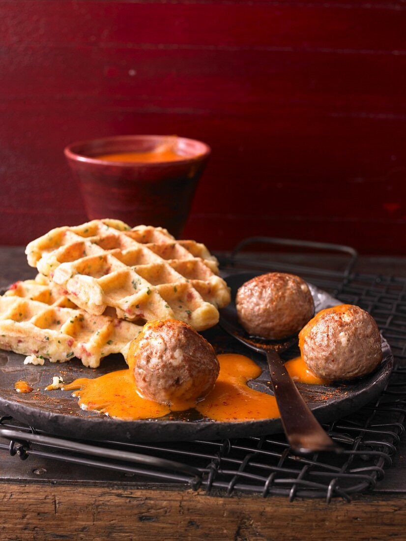 Cauliflower waffles with spicy meatballs in a smoked pepper sauce