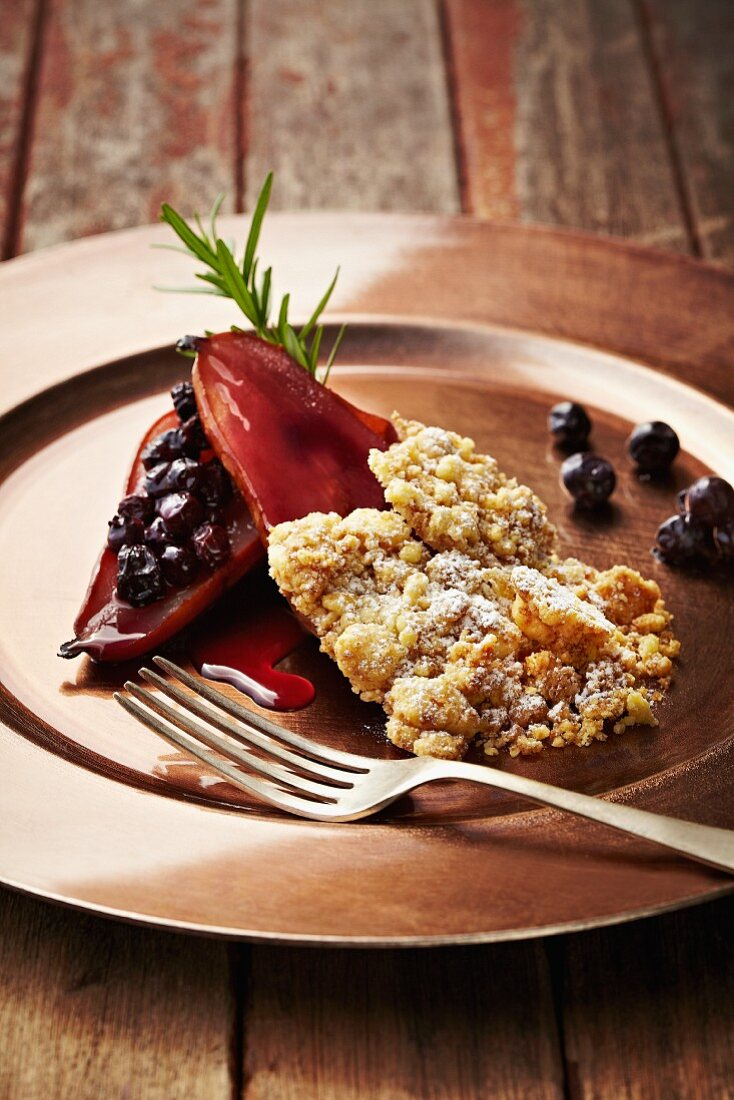 A red wine pear with blueberries and crumbles