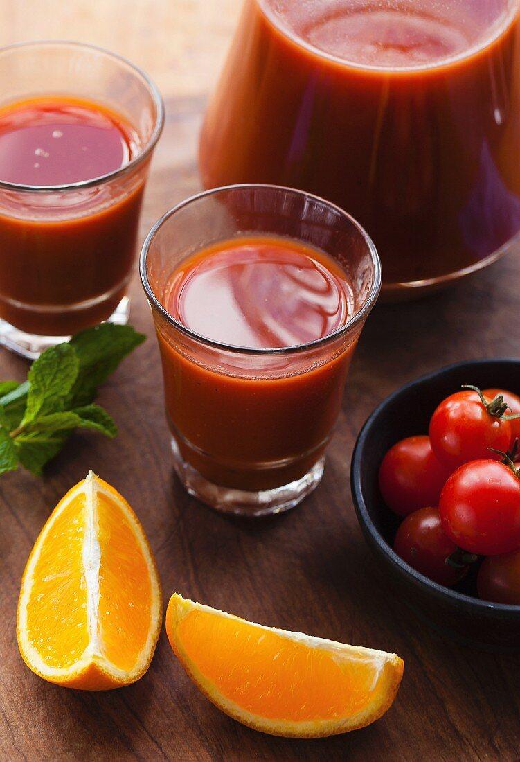 Tomato and orange juice with ingredients