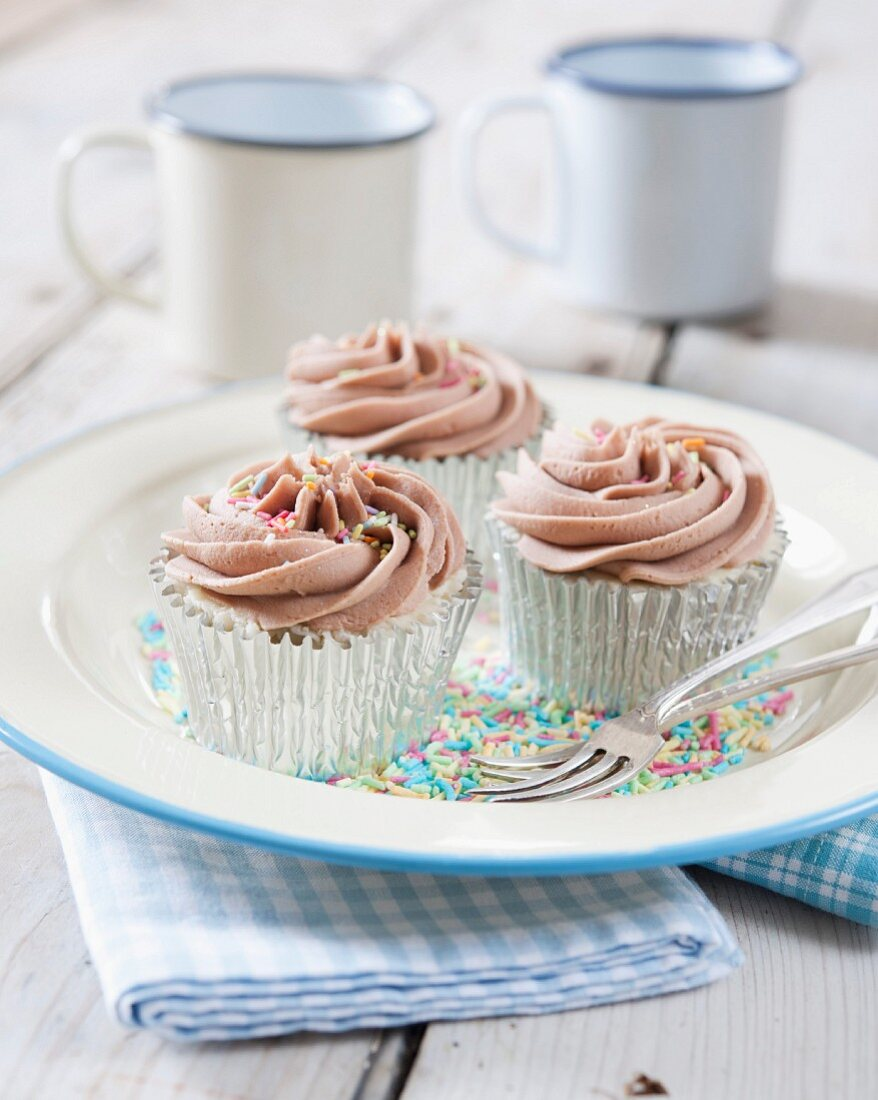 Cupcakes with colourful chocolate sprinkles