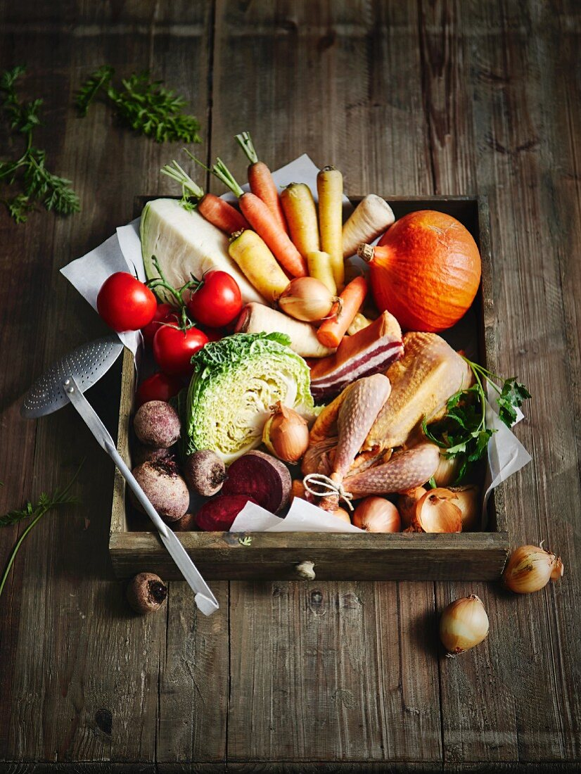 An arrangement of vegetables with chicken (ingredients for stew)