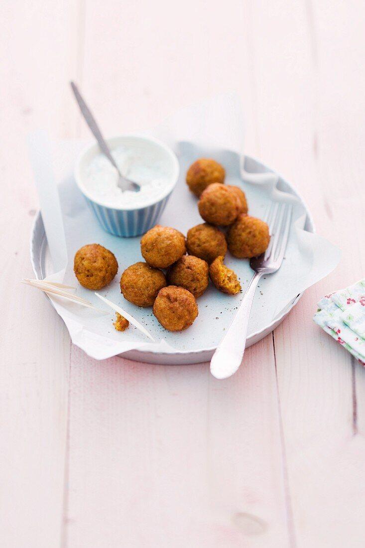 Pumpkin and sweetcorn balls with a yoghurt dip