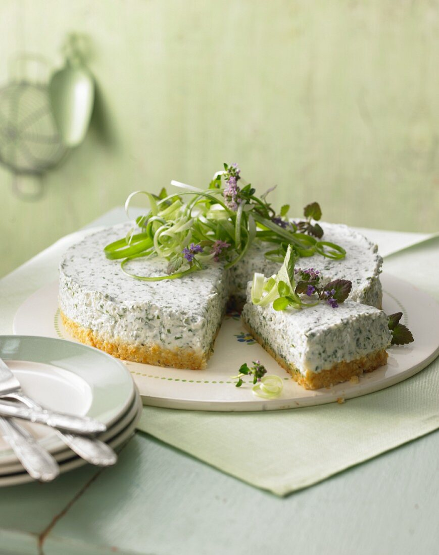 Feta cheese cake with wild herbs
