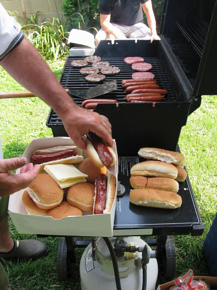 Hot dogs and hamburger on a barbecue