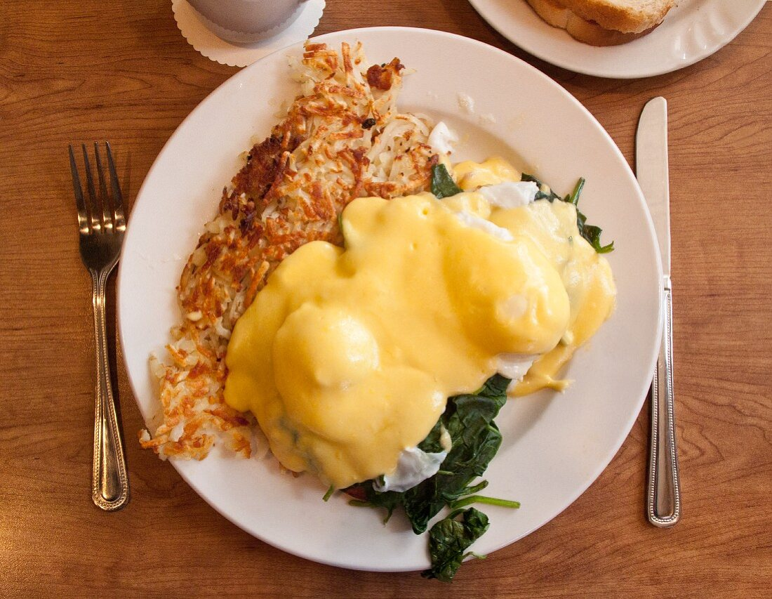 Eggs Benedict with spinach and omelette