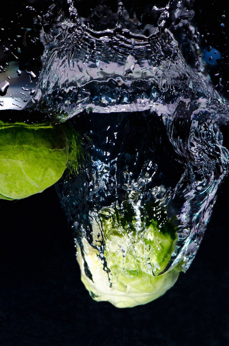Brussels sprouts falling into water
