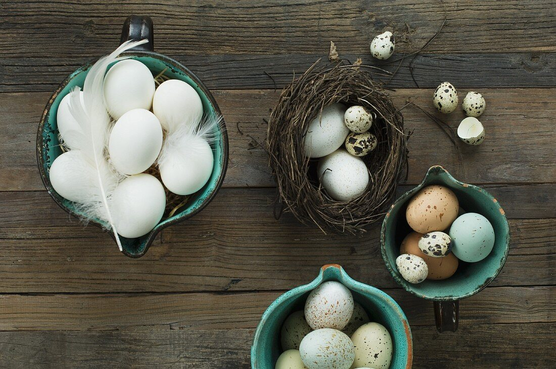 Easter eggs in jugs and in a small Easter nest