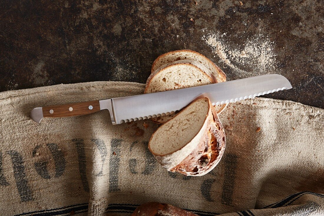 A bread knife and a loaf of bread