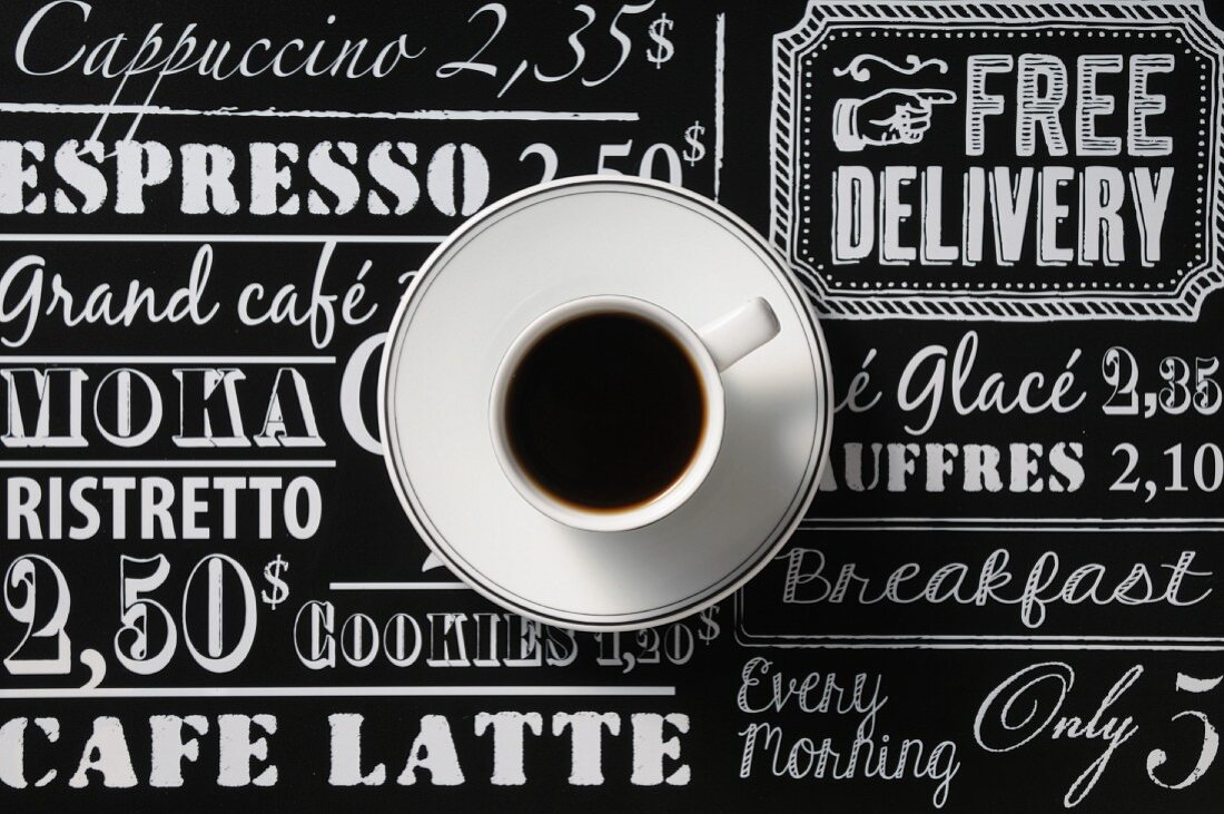 A cup of coffee on a price list