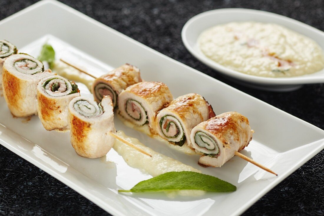 Stuffed pork roll skewers with pear mousse