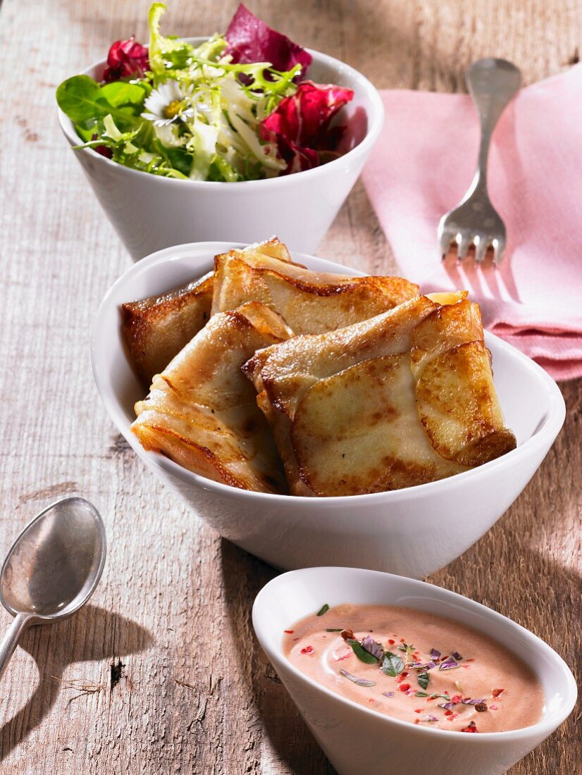 Stuffed potato parcels with a dip and a side salad