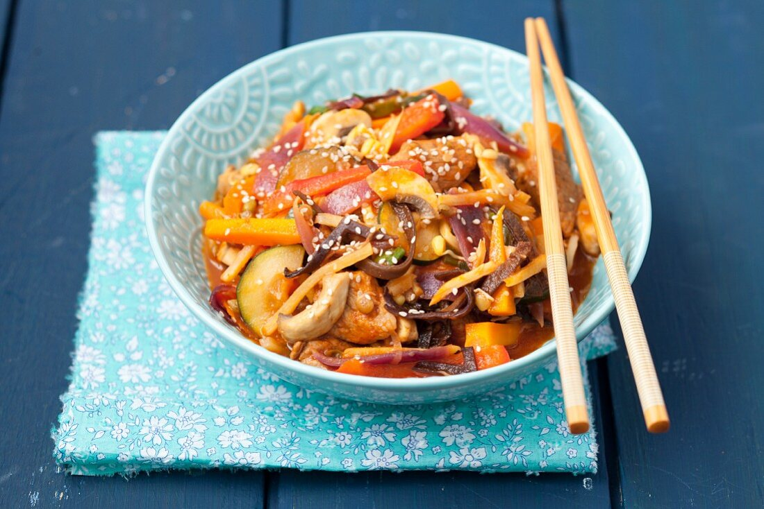 Sweet and sour pork with vegetables and mushrooms (China)
