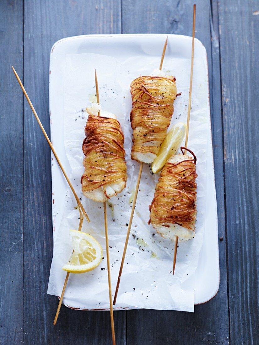 Cod skewers in a potato coating