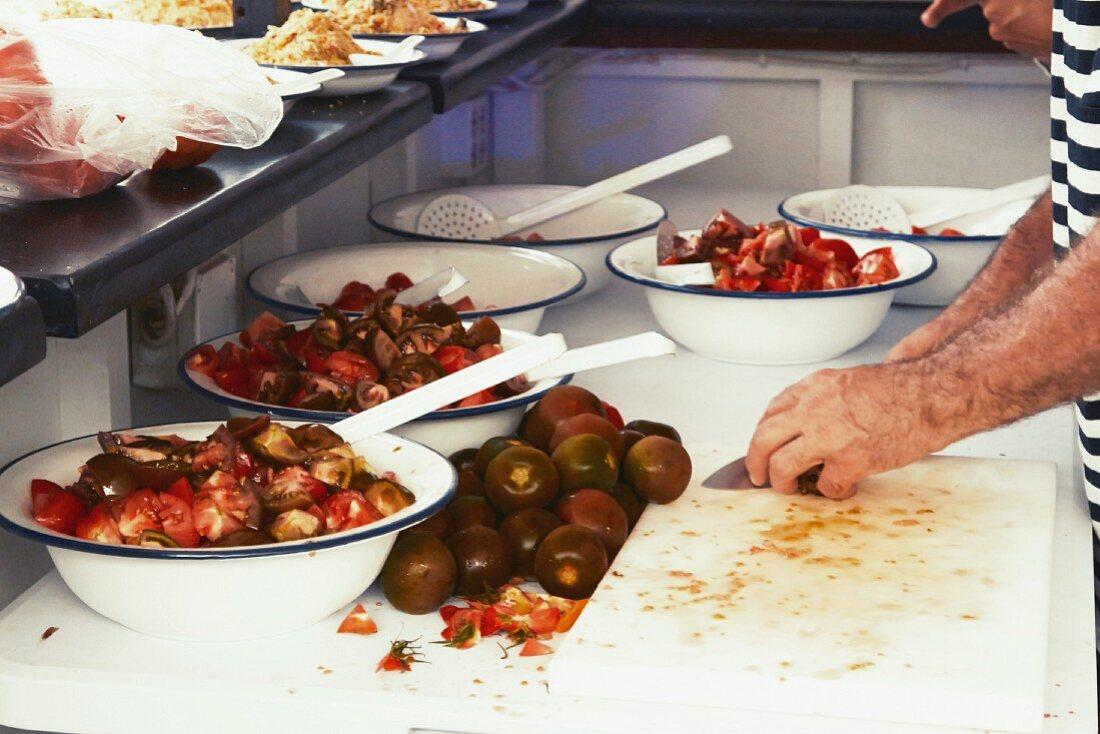 Tomato salad being made in a restaurant kitchen