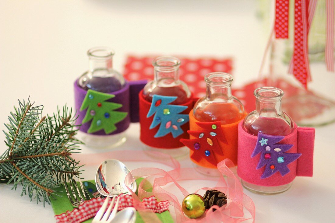 Mini vases with homemade, felt Christmas covers
