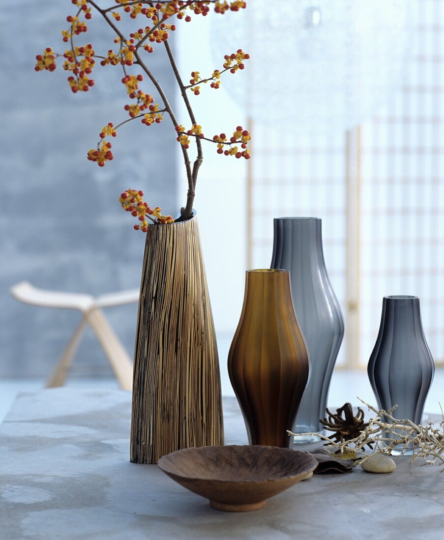 A collection of decorative vases in brown and grey tones