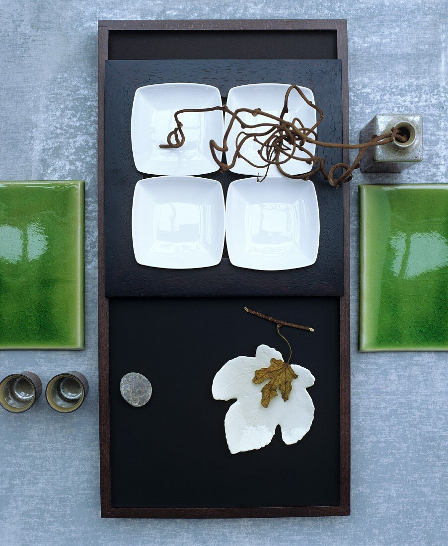 A table laid with oriental plates with natural decorations (seen from above)