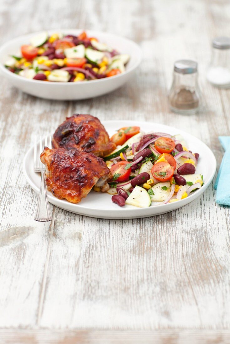Chicken leg with a vegetable salad