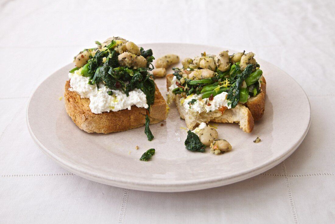 A rustic sandwich with fava beans, spinach and ricotta