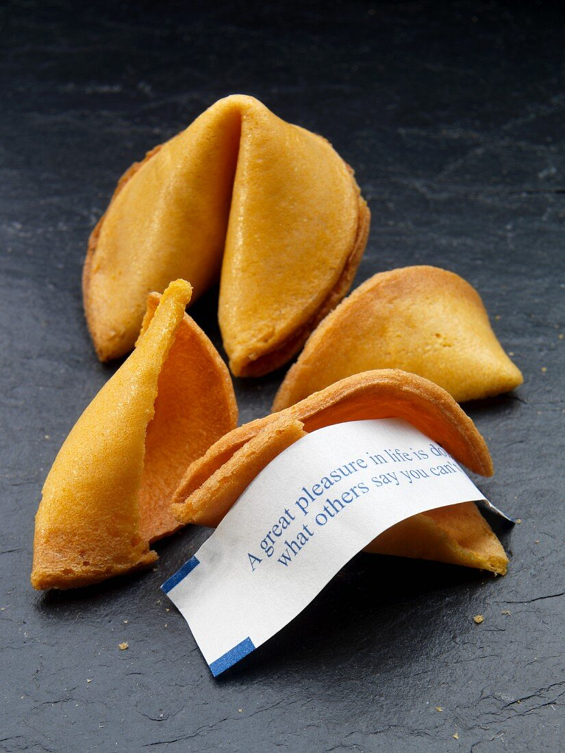 Two fortune cookies, one broken with fortune showing
