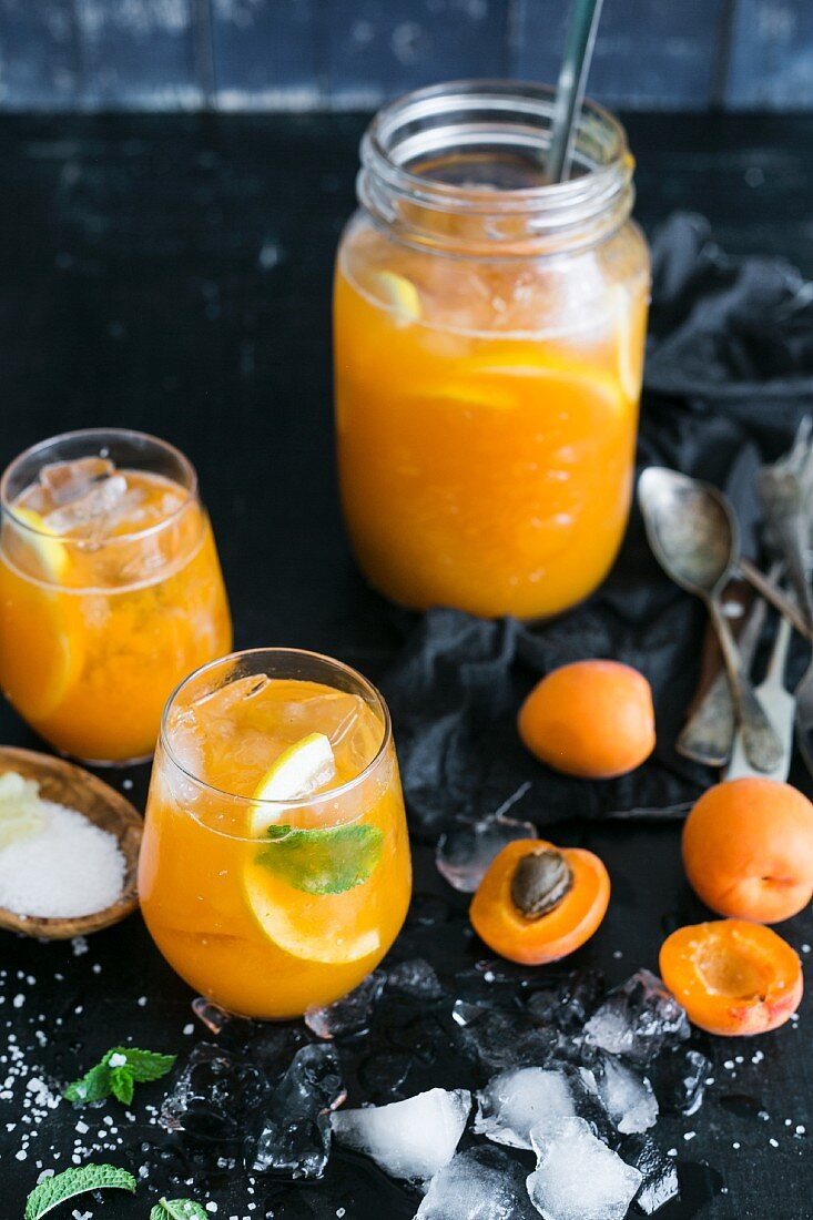 Refreshing apricot punch with lemons, mint and a pinch of salt