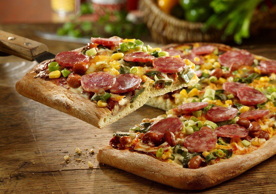 A pepper, chilli and salami pizza