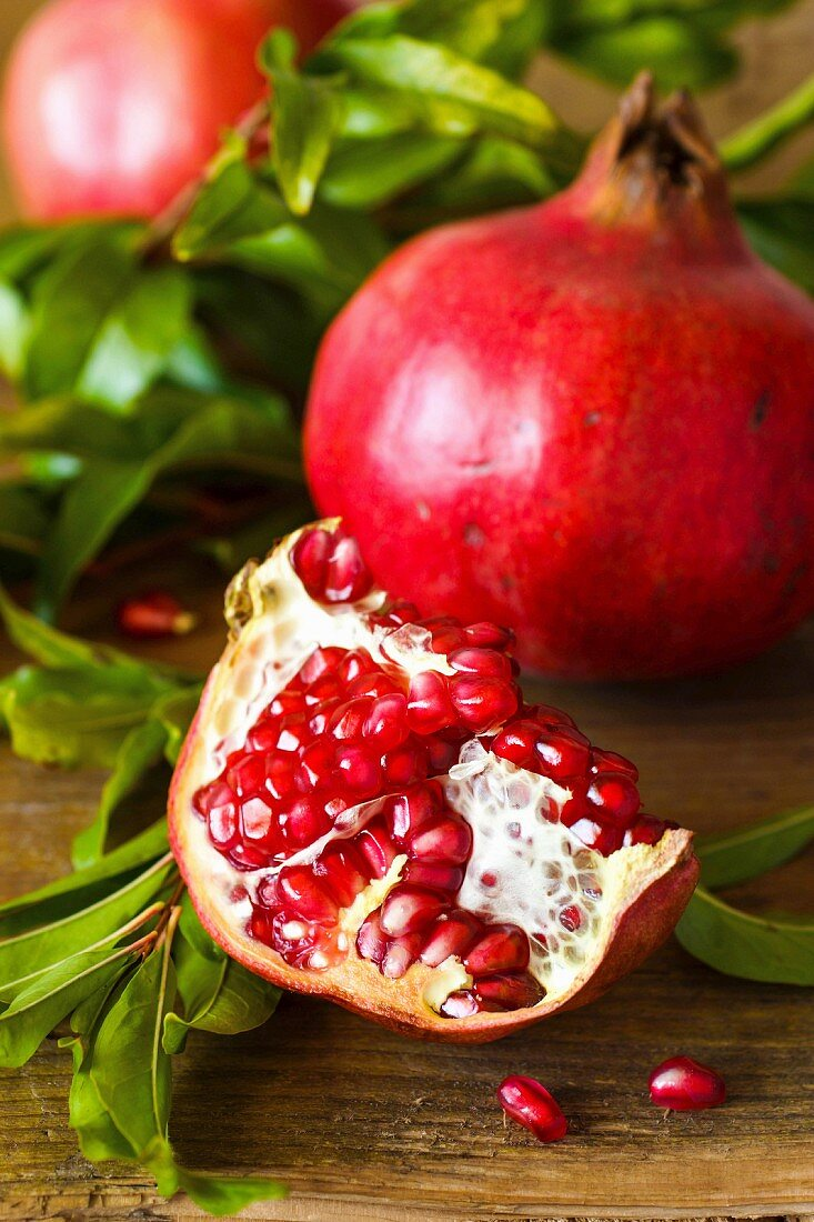 Pomegranates, whole and broken (seen from above)