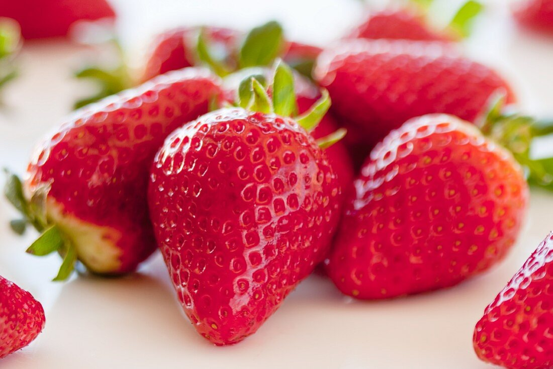 Fresh Strawberries Close Up; One with Stem