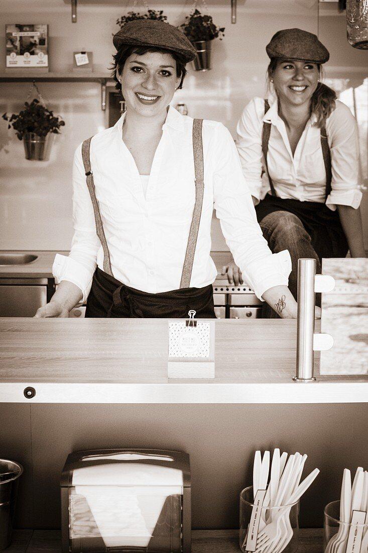 Two women in a food truck