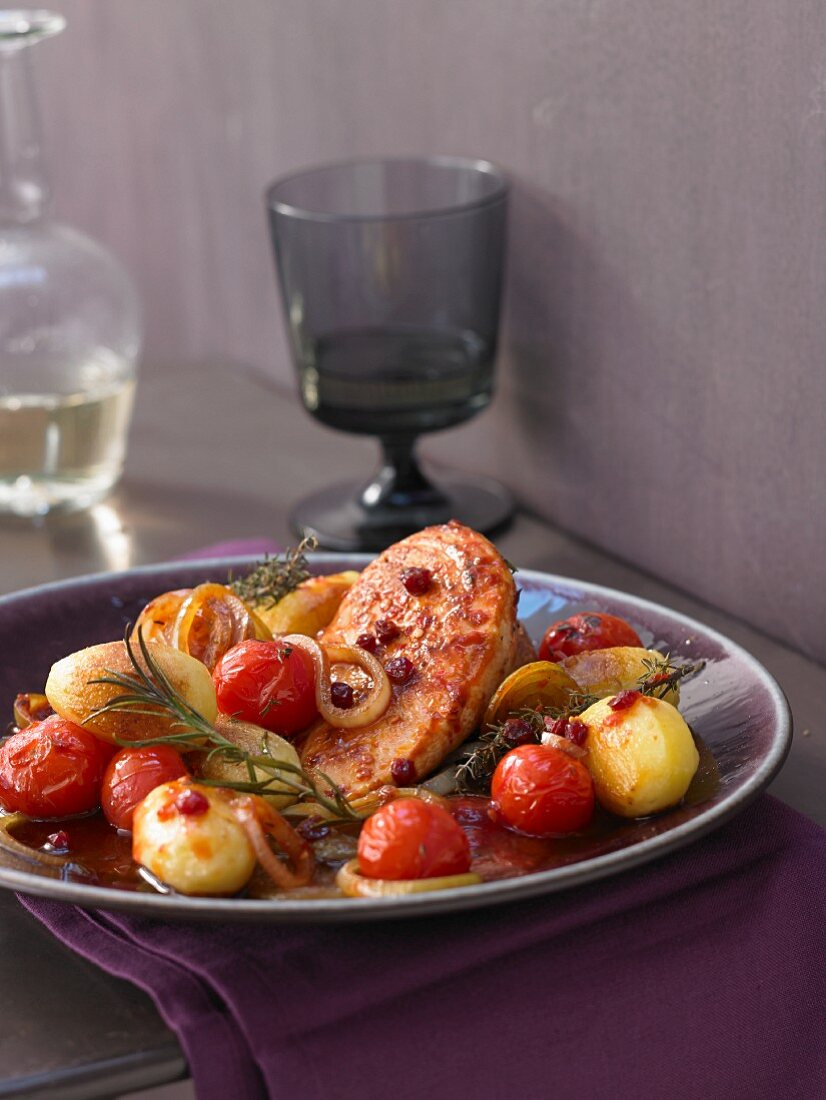 Tuscan chicken bake with potatoes and cherry tomatoes