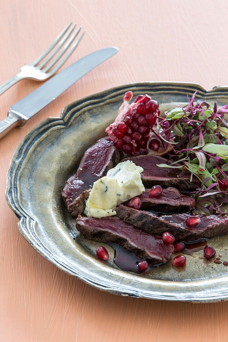 Ostrich fillet with pomegranate dressing