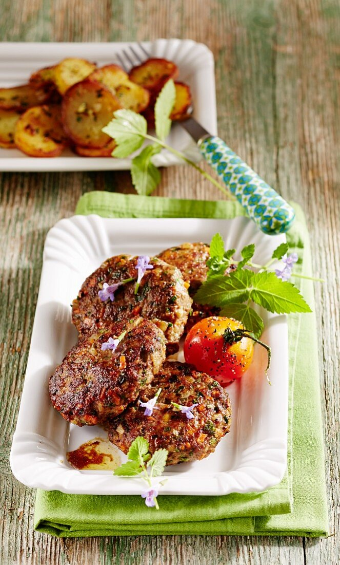 Wild herb patties with fried potatoes